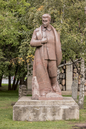 totalitarianism: Moscow, Russia -September 09,2016: Sculpture Joseph Stalin in the park Muzeon,pink granite. Sculptor S. Merkurov. In sculpture split off the nose and feet