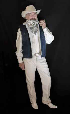 The cowboy with mustache in a white hat, smoking a cigar
