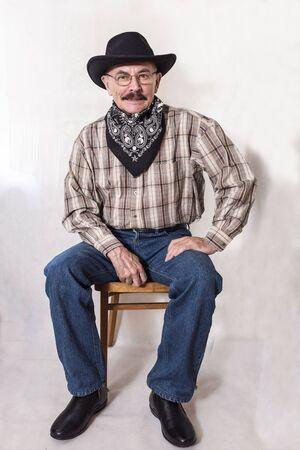 The cowboy with mustache, in a black hat