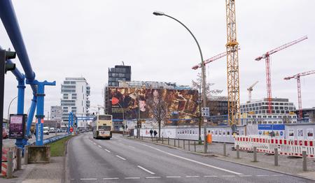frederick street: Berlin,Bundesrepublik Deutschland- December 29,2016: Down the street moving trucks. Citizens go on the sidewalk