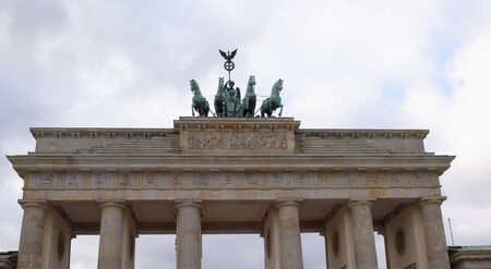 Berlin,Bundesrepublik Deutschland- December 29,2016: Brandenburg Gate - the only surviving city gate, their original name - the Gate of the world. They were built by Carl Gotthard Langhans in 1789-1791 gg. Tourists walk in the gate, and photographed
