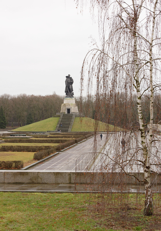 Berlin,Bundesrepublik Deutschland- December 29,2016: Memorial complex of the Soviet Liberator Soldier in Treptow Park.Customers visiting the monument Stock Photo