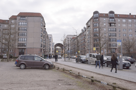 Berlin,Bundesrepublik Deutschland- December 29,2016:The place where was Hitlers bunker. Fyurerbunkere (F�hrerbunker) is located near the Brandenburg Gate.On this site is now parking cars.Next are going pedestrians and passing cars