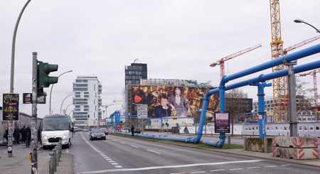 frederick street: Berlin,Bundesrepublik Deutschland- December 29,2016: Down the street moving trucks. Citizens to bus stop gambling