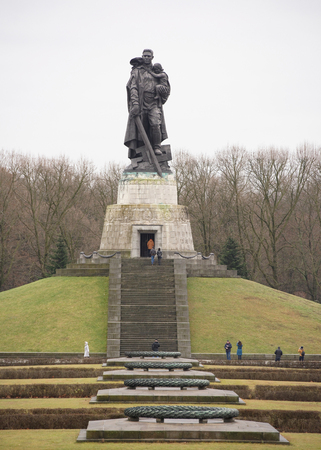 liberator: Berlin,Bundesrepublik Deutschland- December 29,2016: Memorial complex of the Soviet Liberator Soldier in Treptow Park.Customers visiting the monument Editorial