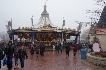 Paris, France- January 02,2017: Visitors are walking in Disneyland Paris in heavy sno Editorial