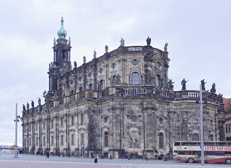 dresden: Dresden, Germany- January 4,2017: The Catholic Church on the Theater Square, on which tourists are walking and transport is moving