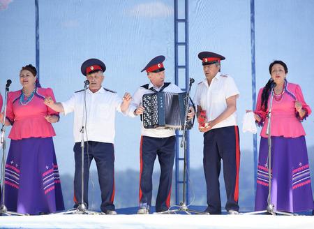cossacks: Razdorskaya,Rostov Region, Russia- June 04; 2017: Group of elderly Cossacks singing at the Trinity