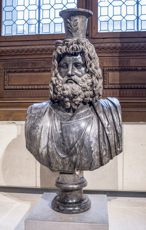 Paris,France- May 03,2017: Bust of Serapis. Collections royales francaises.Louvre Editorial
