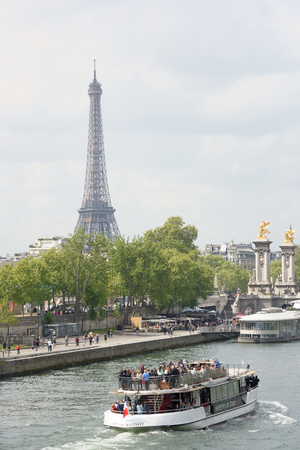 Paris,France- April 29, 2017: On the river Seine sailing ship with cheerful tourists