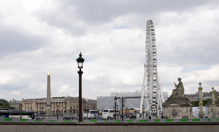Paris,France- April 29, 2017:The Paris wheel on the Place de la Concorde. By area moving vehicles and pedestrians