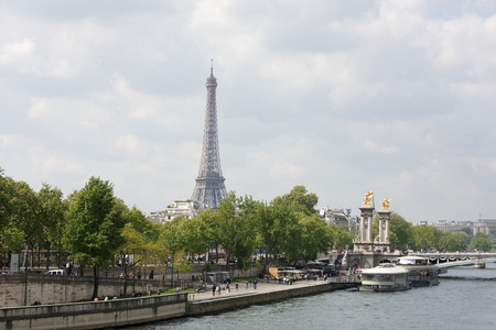 Paris,France- April 29, 2017: View of the Alexander lll Bridge . By the embankments are moving cars and pedestrians