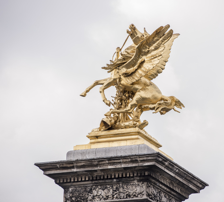 Paris,France- April 29, 2017: Statue on the Alexander Bridge lll Редакционное