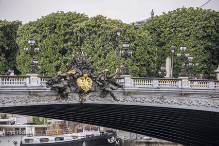 Paris,France- April 29, 2017: View of the Alexander lll Bridge. Nymph of the Neva with official symbols of Czarist Russia Sajtókép