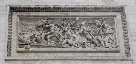 Paris; France- May 01; 2017: Triumphal arch on the Champs Elysees.Bas-relief The Battle of Arcola with the Austrian army in 1796. Napoleon showed heroism, leading the attack on the Arkolsky Bridge with a banner in his hands. Redakční