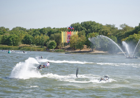 propulsion: Rostov-on-Don, Russia- September 16,2017: The athlete flies with a water jet from the side of a water motorcycle in front of the audience at the celebration of the day of the city of Rostov-on-Don