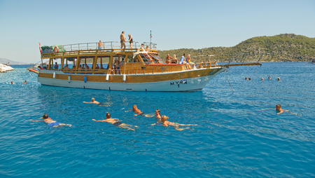 Demre;Turkey-September 08;2017:Tourists swim in the sea from the ships side