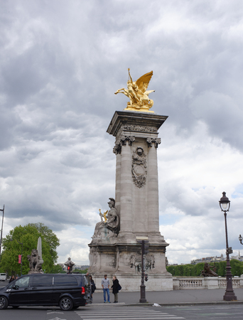 Paris; France-May 02; 2017: View of the Pont Alexandre lll. On the bridge are pedestrians and cars Editorial