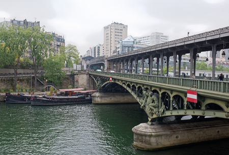 Paris; France-May 05; 2017: View of the Bir-Hakeim bridge. Pedestrians and vehicles are moving along the bridge Editorial