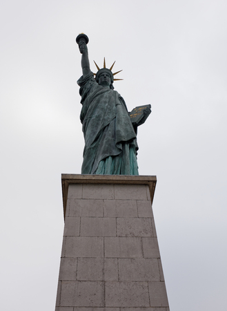 Paris; France-May 05; 2017: The swan island became a haven for a smaller Statue of Liberty. The copper lady, 11.5 meters high, peers at the distant shores of the American continent