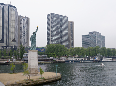 Paris; France-May 05; 2017:The swan island became a haven for a smaller Statue of Liberty. The copper lady, 11.5 meters high, peers at the distant shores of the American continent