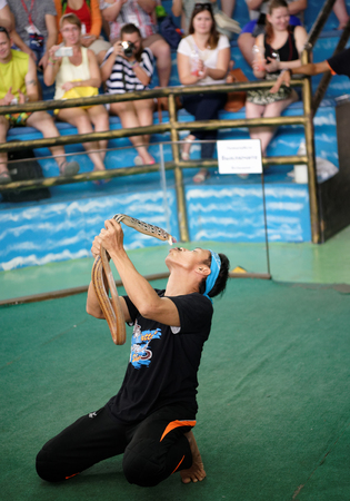Pattaya,Thailand- November 20,2017: Show of snakes. Performer play with snake during a show in Pattaya Snake Show