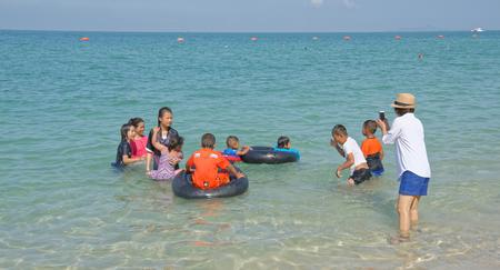 Pattaya,Thailand- November 22;2017: Sai Kaew Beach Sattahip-Military Beach. Children play in the water and bathe. Mom takes pictures Editorial