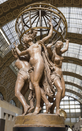 Paris,France- May 02,2017: Museum of Orsay.The four parts of the world supporting the celeste sphere.Model plaster shellac. 1872 Editoriali