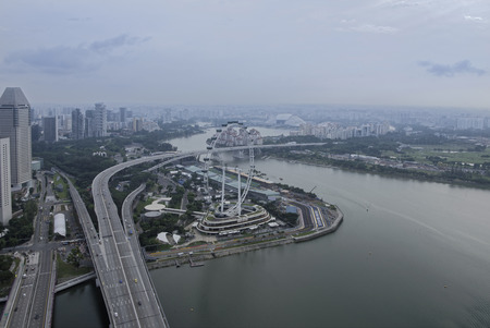 Singapore, August 07, 2018: View of Singapore Flyer from the observation deck of the hotel Marina Bay Sands