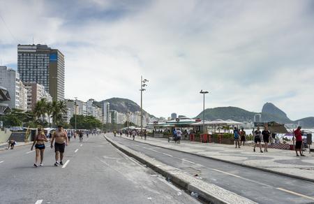Rio de Janeiro, Brasil- March 04,2019: View of the Avenida Atlantica. People go about their business Editorial
