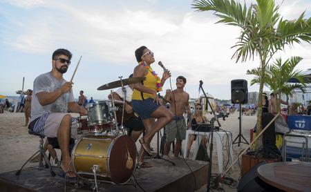 Rio de Janeiro, Brasil- March 05,2019: The ensemble performs in a cafe on Copacabana Beach. Citizens go about their business