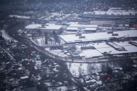 Moscow; Russia- March 08; 2019: View of the snow-covered suburbs of Moscow from an airplane Editorial