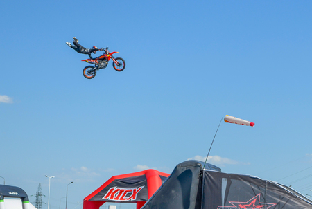 Rostov-on-Don, Russia -June 09, 2019 :Moto freestyle. Jumping with stunning tricks in the sky -incredible sight