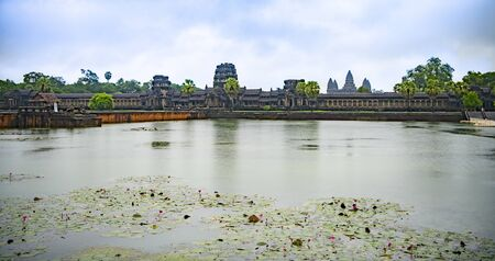Angkor Wat is the largest temple in the world (Cambodia, 2019). It is raining. Lotuses Stock fotó - 130337494