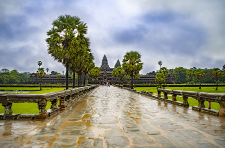 Angkor Wat,Cambodia-September 04, 2019: Angkor Wat-largest temple in the world. It is raining. Tourists walk around the temple Stock fotó - 130294197