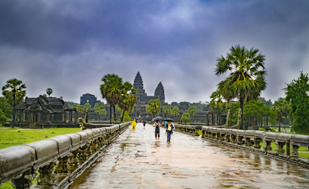 Angkor Wat,Cambodia-September 04, 2019: Angkor Wat-largest temple in the world. It is raining. Tourists walk around the temple Stock fotó - 130294199