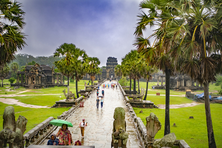 Angkor Wat,Cambodia-September 04, 2019: Angkor Wat-largest temple in the world. It is raining. Tourists walk around the temple Sajtókép
