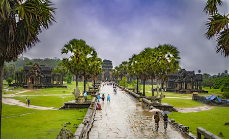 Angkor Wat,Cambodia-September 04, 2019: Angkor Wat-largest temple in the world. It is raining. Tourists walk around the temple Stock fotó - 131173839