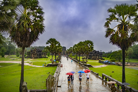 Angkor Wat,Cambodia-September 04, 2019: Angkor Wat-largest temple in the world. It is raining. Tourists walk around the temple Stock fotó - 131173841