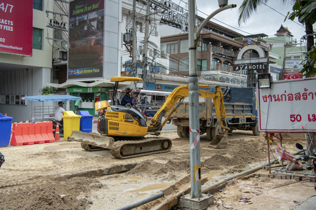 Pattaya, Thailand , September 8, 2019: Construction of sewage on Beach Street. Pedestrians and vehicles move along the street Editorial