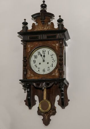Vintage wooden clock with a pendulum