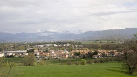 Village in a picturesque valley at the foot of the mountains. Italy Stock fotó