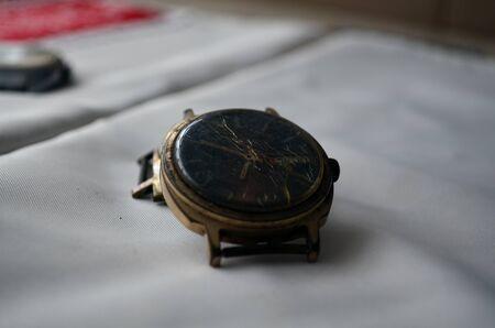Broken gold soviet watch on the table