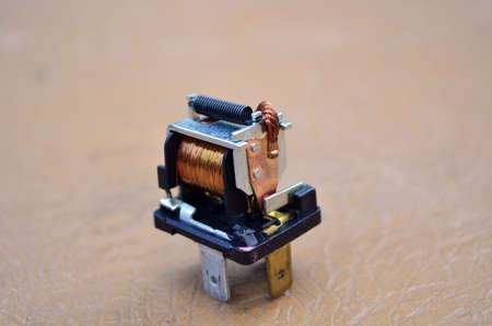 Used automotive turns relay on wooden table