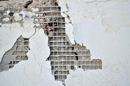 fragment of a damaged plaster wall in abandoned house