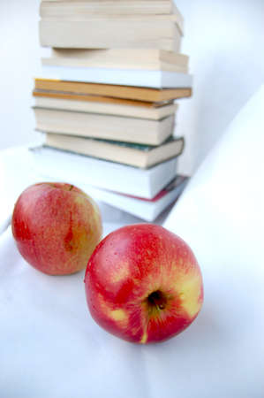 Two apples and pile of books