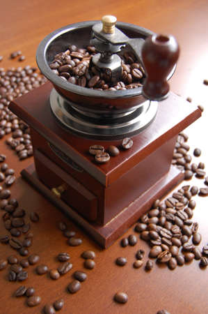 Coffee grinder with beans photo