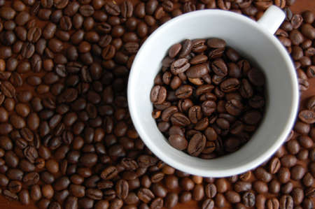 A cup of coffee with beans Stock Photo