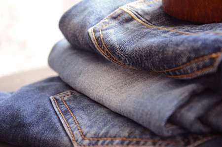 suede belt: Pile of Jeans Close Up Stock Photo