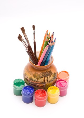 Paints, pensils and brushes Stock Photo
